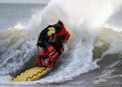 PWC With LifeSled Crashing Through Surf